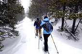 Couple snowshoeing in the Colorado mountains