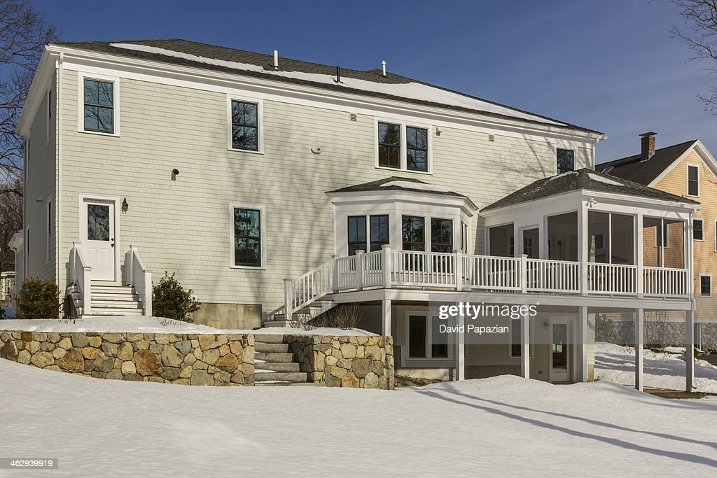 Snowy backyard and home exterior : Stock Photo