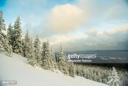 Snowy hillside over remote landscape