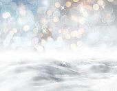 3D render of a snowy landscape against a bokeh lights background