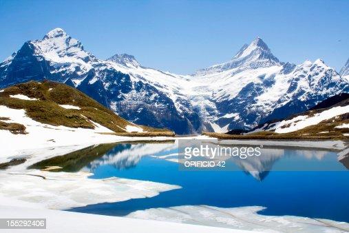 Snowy landscape reflected in still lake
