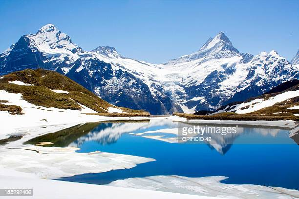 Snowy landscape reflected in still lake