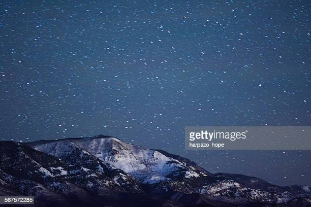 Snowy mountain at night.