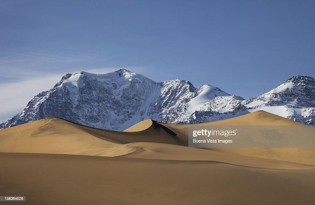 Snowy mountain in a desert. : Stock Photo