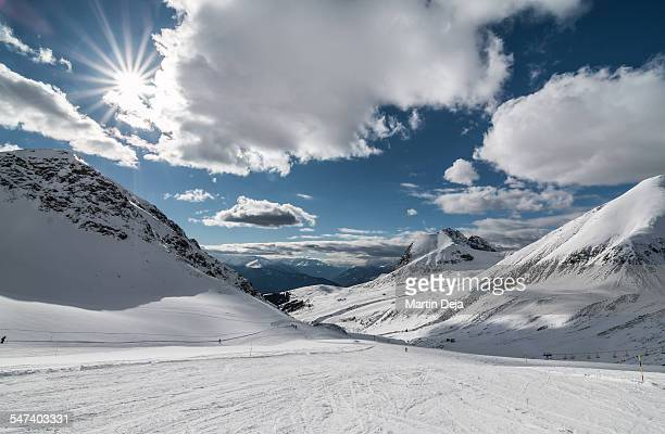 Snowy mountains on a sunny day with clouds