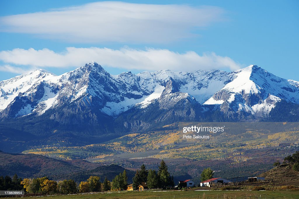 Snowy mountains overlooking rural landscape