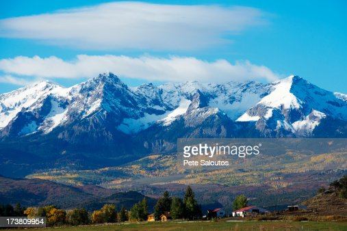 Snowy mountains overlooking rural landscape : Stock Photo