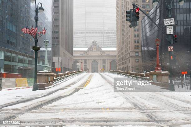 Snowy Park Avenue during the snowstorm at Midtown Manhattan on Mar. 14 2017. Grand Central Terminal can be seen behind.