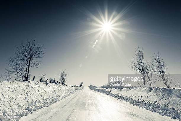 Snowy path under a bright sun