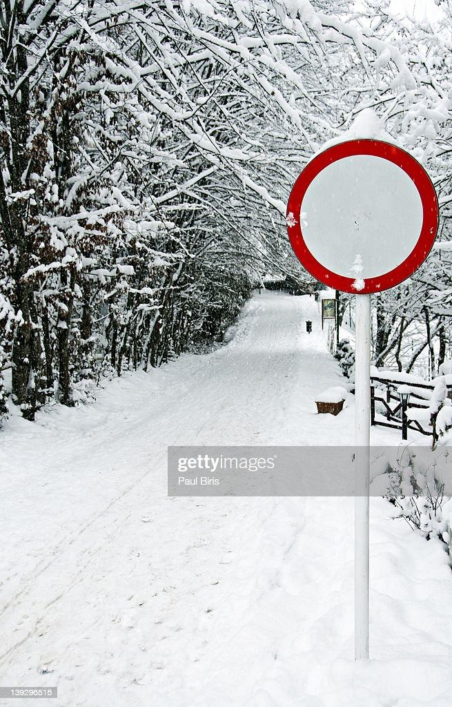 Snowy path with sign board : Stock Photo