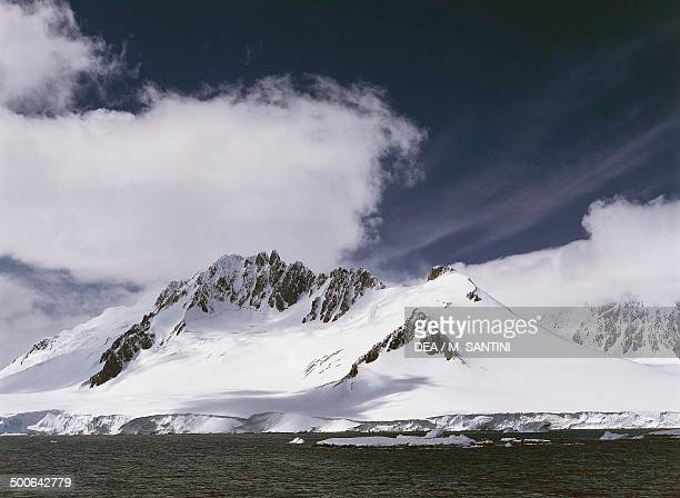 Snowy peaks west coast of the Antarctic Peninsula Antarctica