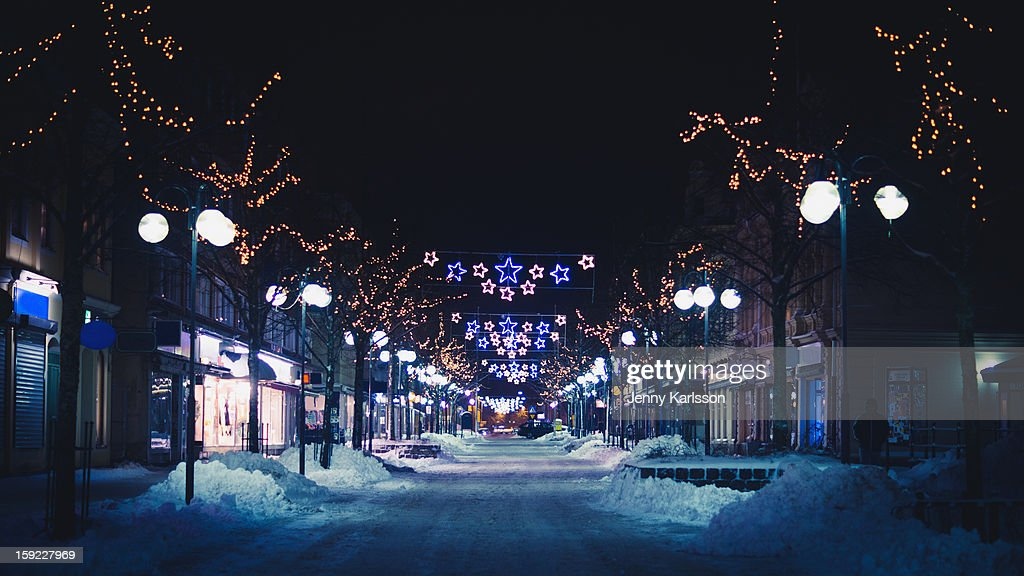 Snowy shopping street with Christmas lights : Stock Photo