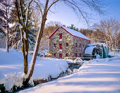snowy winter gristmill, early morning light