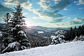 Snowy winter landscape at sunset. National park Sumava in Czech Republic.