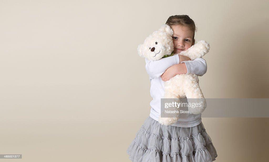 Snuggling her bear