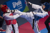 So Hee Kim of Korea competes with Gunay Aghakishiyeva of Azerbaijan during a Women's 57 kg combat of WTF World Taekwondo Championships 2013 at the...