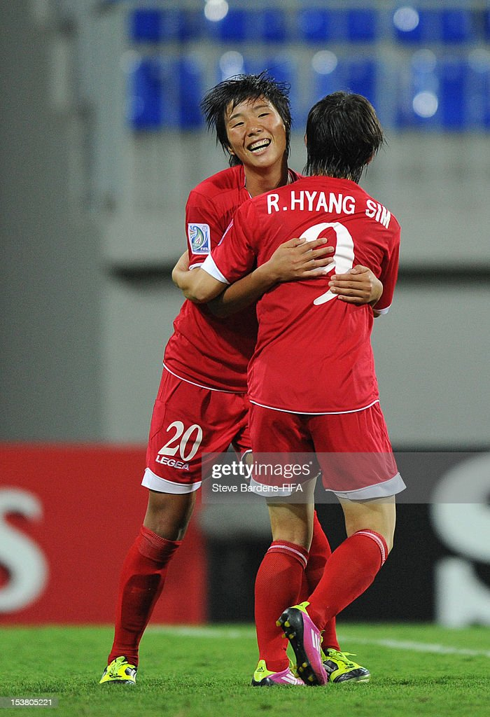 So Hyang Kim of Korea DPR celebrates scoring the second goal withHyang Sim Ri during the FIFA U-17 Women's World Cup 2012 Semi-Final match between Korea DPR and Germany at 8KM Stadium on October 9, 2012 in Baku, Azerbaijan.