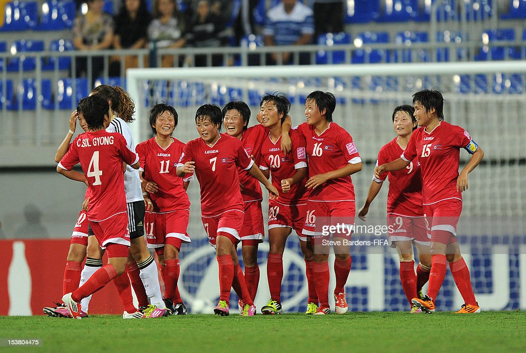 So Hyang Kim of Korea DPR (4th R) celebrates with team-mates after scoring the opening goal of the FIFA U-17 Women's World Cup 2012 Semi-Final match between Korea DPR and Germany at 8KM Stadium on October 9, 2012 in Baku, Azerbaijan.