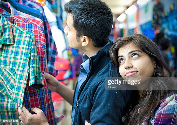 So in love. Young indian couple shopping.