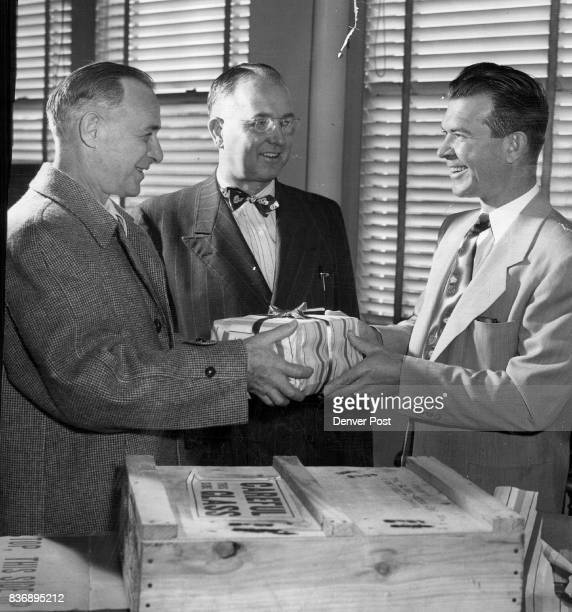 1952 JAN 4 1952 'So Long Boss'Fire Chief Allie Feldman and Police Chief Herbert Forsyth present a set of law books and bookcases to Harold A...