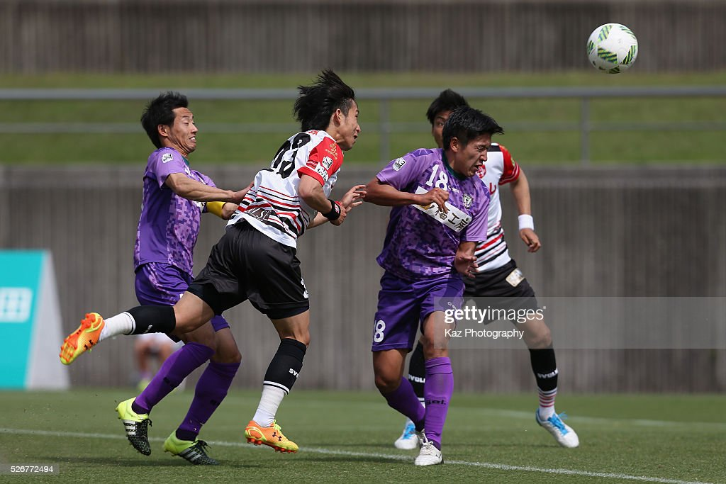 So Morita (2nd L) of Grulla Morioka shoots at goal during the J.League third division match between Fujieda MYFC and Grulla Morioka at the Fujieda Stadium on May 1, 2016 in Fujieda, Shizuoka, Japan.