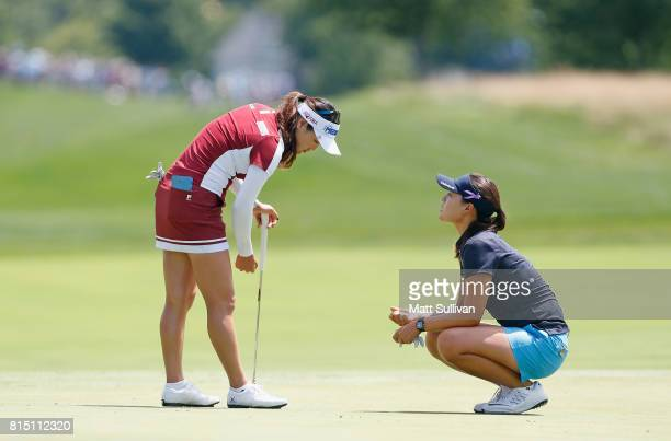 So Yeon Ryu and In Gee Chun both of South Korea talk on the green at the first hole during the third round of the US Women's Open Championship at...
