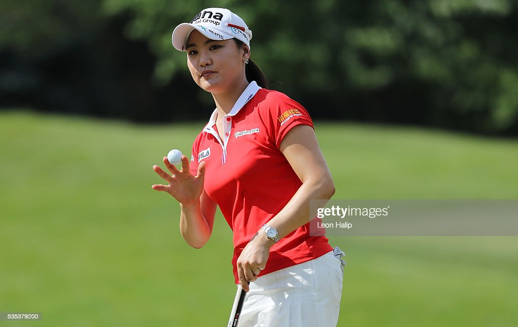 So Yeon Ryu from South Korea waves to the fans on the eleventh hole during the final round of the LPGA Volvik Championship on May 29, 2016 at Travis Pointe Country Club in Ann Arbor, Michigan.