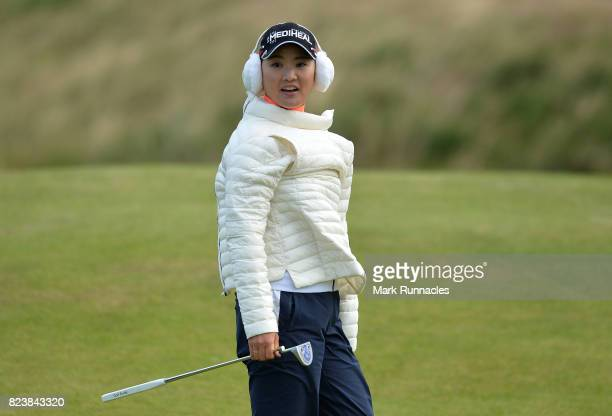 So Yeon Ryu of Korea puts on her coat in the windy conditions at the 17th during the second day of the Aberdeen Asset Management Ladies Scottish Open...