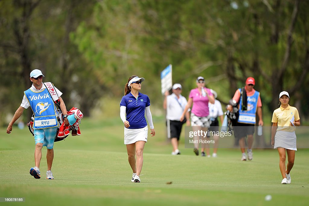 So Yeon Ryu of South Korea (L) and Minjee Lee of Australia walk up the 9th hole fairway during the Australian Ladies Masters at Royal Pines Resort on February 3, 2013 on the Gold Coast, Australia.