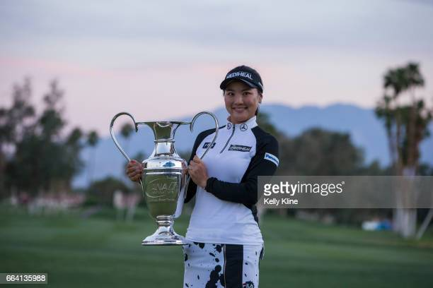 So Yeon Ryu of South Korea holds the trophy after defeating Lexi Thompson in a playoff to win the 2017 ANA Inspiration at Mission Hills Country Club...