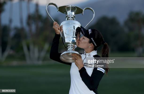 So Yeon Ryu of South Korea holds the trophy aloft after her playoff win during the final round of the 2017 ANA Inspiration held on the Dinah Shore...