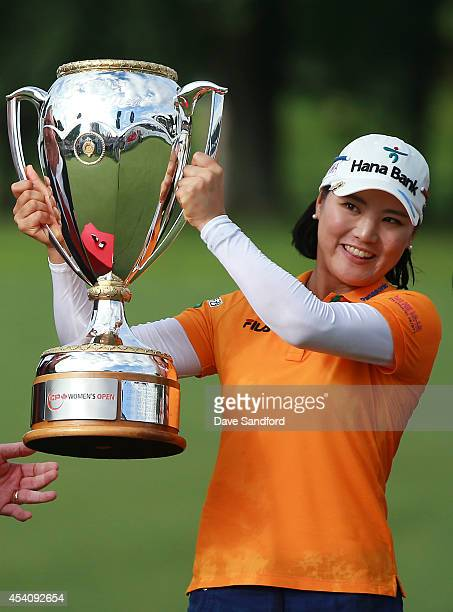 So Yeon Ryu of South Korea holds up the championship trophy as she celebrates her two stroke victory during the fourth round of the LPGA Canadian...