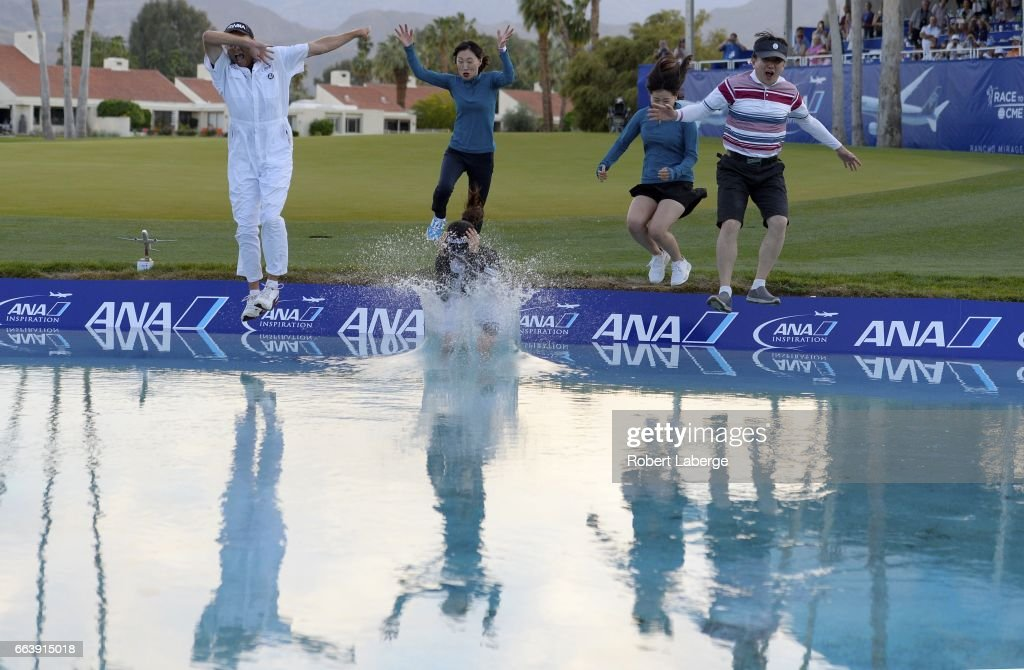 So Yeon Ryu of South Korea jumps in the water with her caddie Tom Watson, her mother Kwang-Ja Cho, her sister So-Myung Ryu and guest Sang-Jin Jang after winning the ANA Inspiration on the Dinah Shore Tournament Course at Mission Hills Country Club on April 2, 2017 in Rancho Mirage, California.