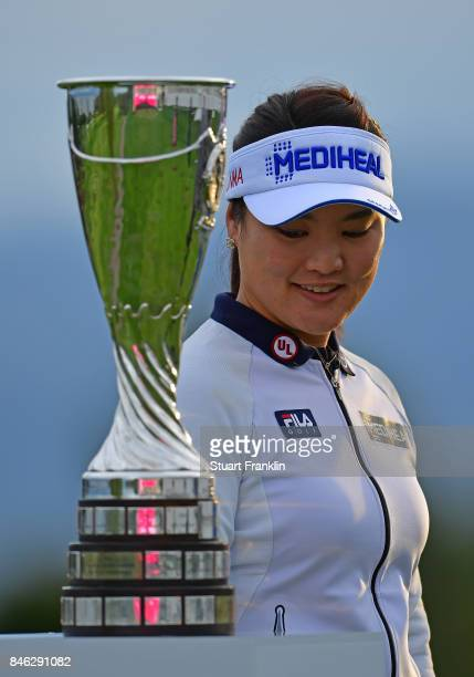 So Yeon Ryu of South Korea looks at the winners trophy during the pro am prior to the start of The Evian Championship at Evian Resort Golf Club on...
