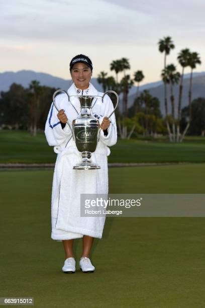 So Yeon Ryu of South Korea poses with the winner's trophy after winning the ANA Inspiration on the Dinah Shore Tournament Course at Mission Hills...