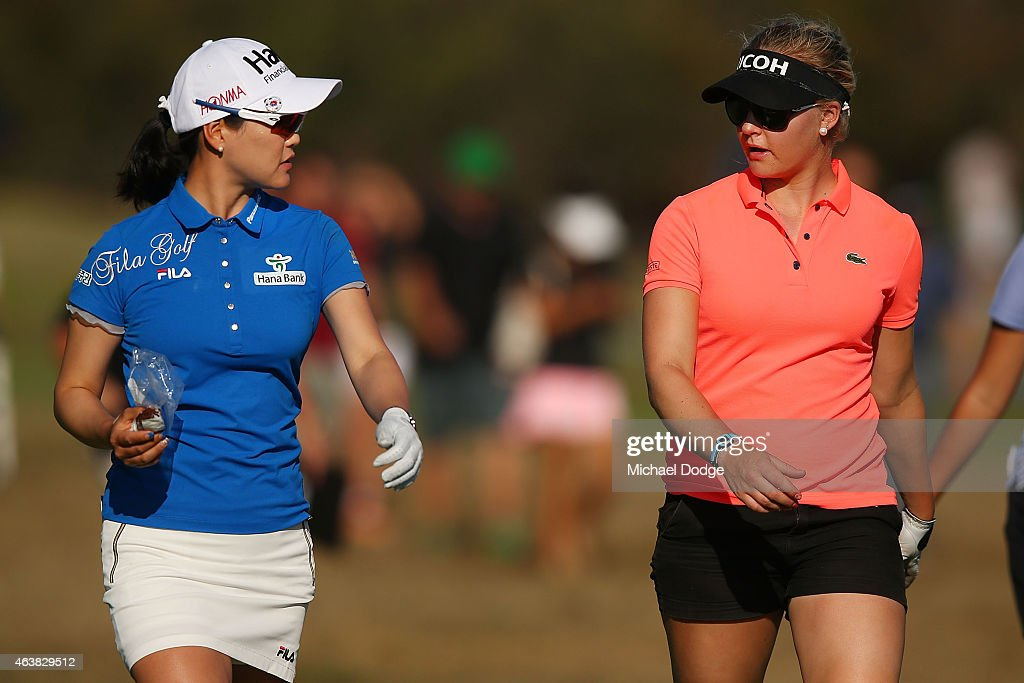So Yeon Ryu of South Korea talks to Charley Hull of England on the 18th hole during day one of the LPGA Australian Open at Royal Melbourne Golf...