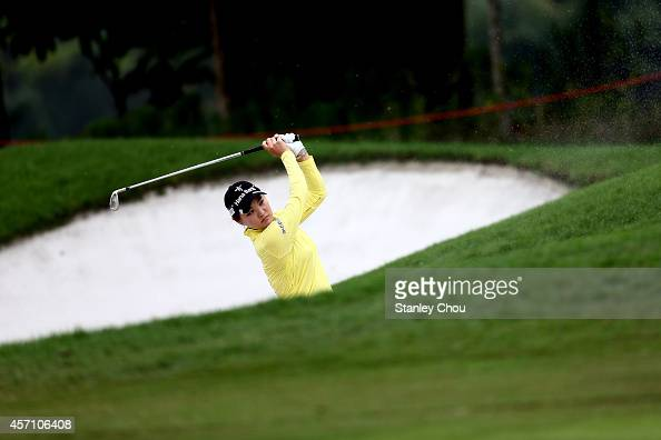 So Yeon Ryu of South Korea watches her bunker shot on the 4th hole during the final day of the Sime Darby LPGA at Kuala Lumpur Golf Country Club on...