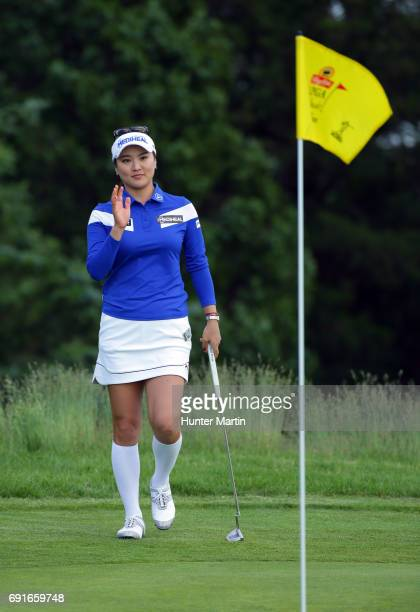 So Yeon Ryu of South Korea waves to the crowd after making birdie on the 15th hole during the first round of the ShopRite LPGA Classic presented by...