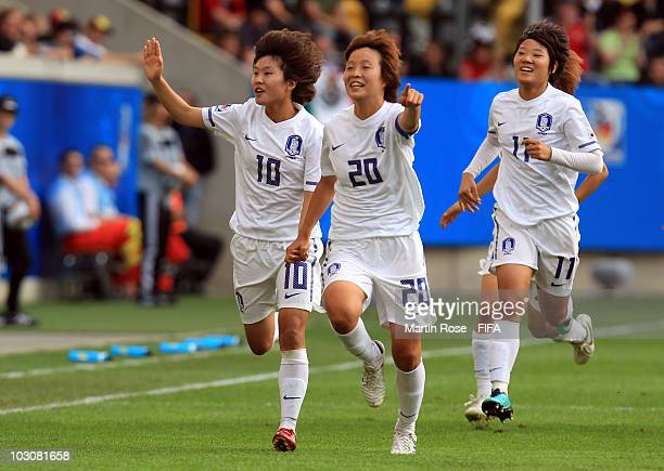 So Yun Ji of South Korea celebrates with team mate Hye Ri Kim after she scores the 2nd goal during the 2010 FIFA Women's World Cup Quarter Final...
