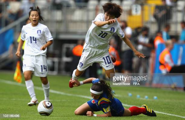 So Yun Ji of South Korea jumps over Natalia Gaitan of Columbia during the 2010 FIFA Women's World Cup third place match between South Korea and...