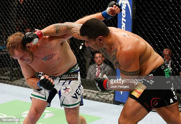 Soa Palelei punches Jared Rosholt in their heavyweight fight during the UFC Fight Night event at Vector Arena on June 28 2014 in Auckland New Zealand