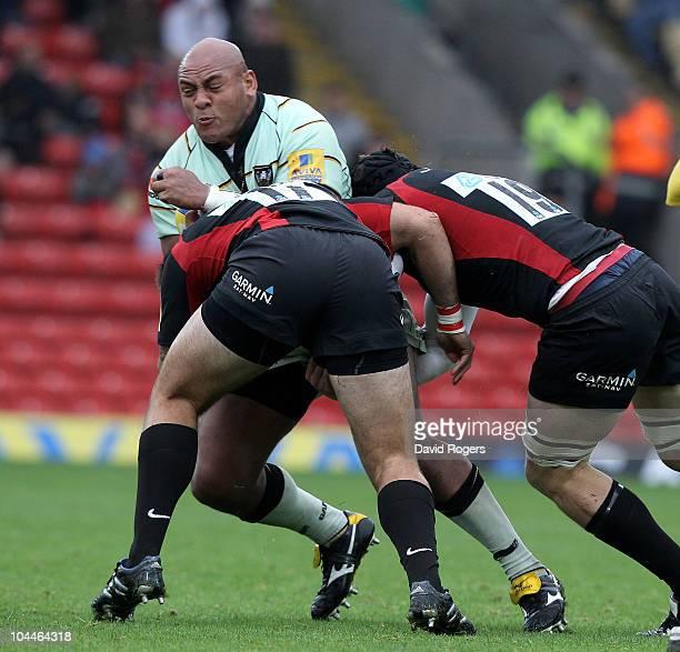 Soane Tonga'uiha of Northampton is tackled by Matt Parr and Hayden Smith during the Aviva Premiership match between Saracens and Northampton Saints...