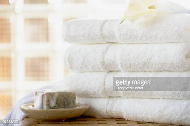 Soap and folded white towels