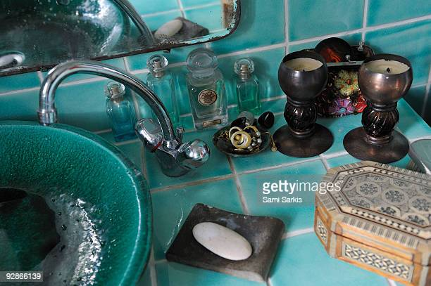 Soap and jewels beside washbasin and faucet