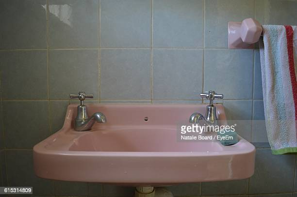 Soap And Old-Fashioned Taps On Pink Bathroom Sink