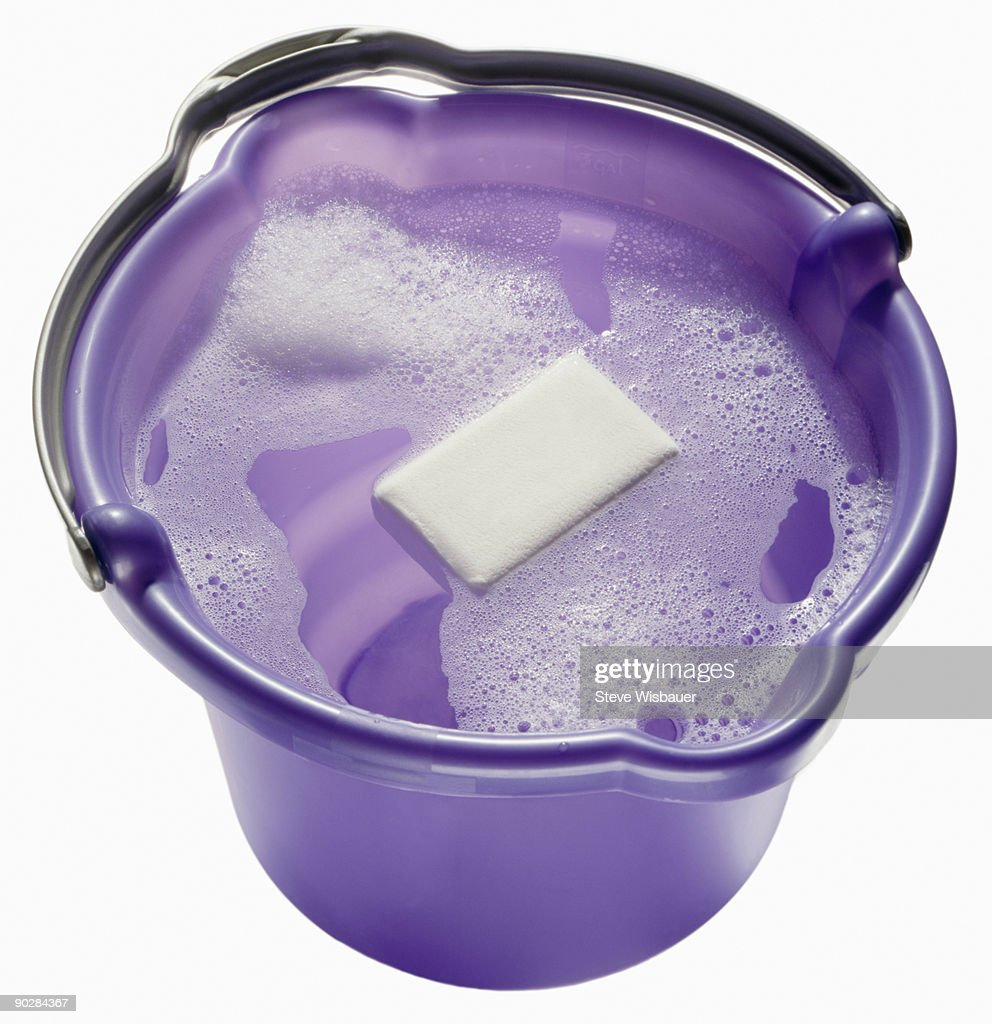 Soap and water in purple bucket