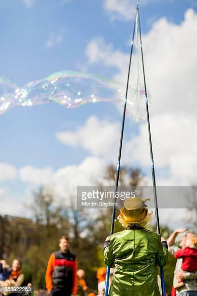 Soap bubble artist entertaining kids