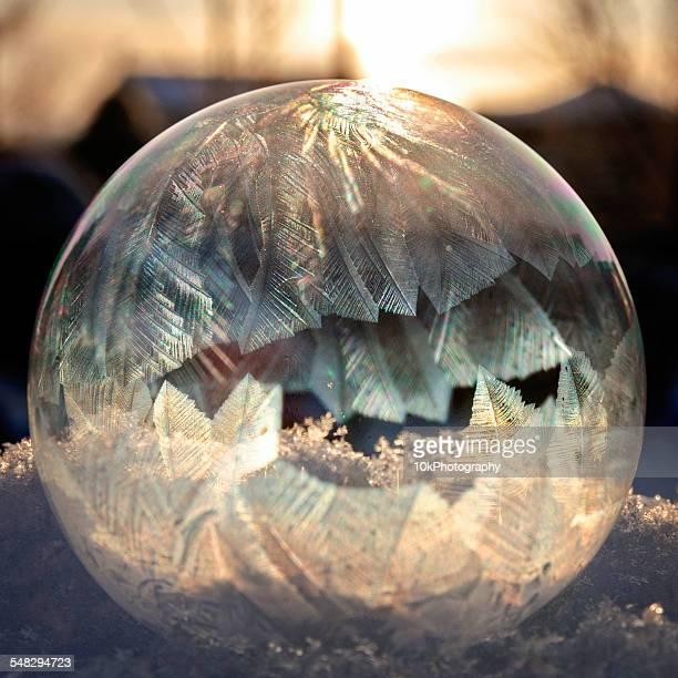 A soap bubble freezing in sun