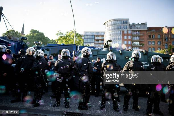 Soap bubbles fly in front on policemen in Hamburg Germany on July 6 2017 The police stopped the leftradical demonstration quotG20 Welcome to Hellquot...