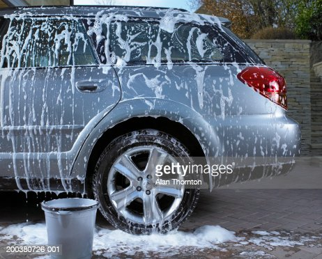 Soap suds and water on car : Photo
